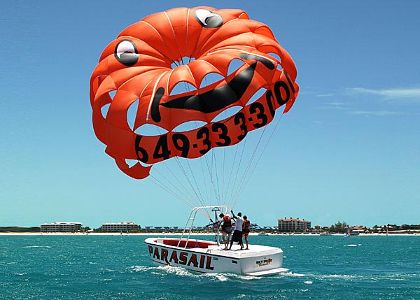 A photograph of parasailing in Grace Bay, Providenciales (Provo), Turks and Caicos Islands, British West Indies