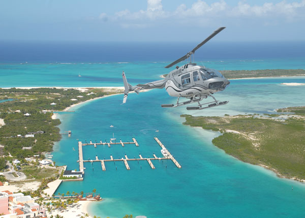 A photograph of a helicopter tour flying over Leeward, Providenciales (Provo), Turks and Caicos Islands, British West Indies