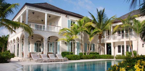 A photograph of Amazing Grace, a 12,000 sq ft private colonial style villa on Grace Bay, Turks and Caicos, designed by SWA Architects.