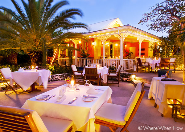 A photograph of The gingerbread cottage and enchanting gardens at the restaurant at Point Grace,  Providenciales (Provo), Turks and Caicos Islands.