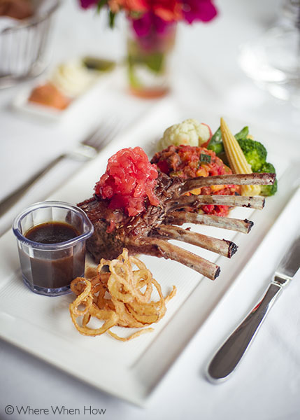 A photograph of Lavender marinated lamb rack topped with pineapple mint chutney.Grace's Cottage, Grace Bay, Providenciales (Provo), Turks and Caicos Islands.