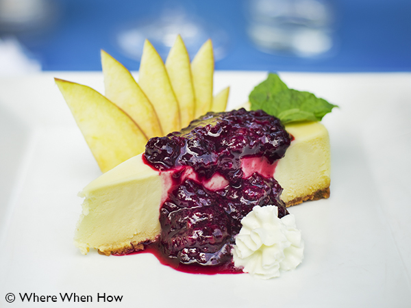 A photograph of Dessert of Vanilla Cheescake with Berry topping at Ocean Club Plaza, Providenciales (Provo), Turks and Caicos Islands.
