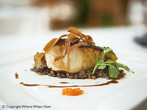 A photograph of Black Cod with Puy lentils at Parallel23, Providenciales (Provo), Turks and Caicos Islands.