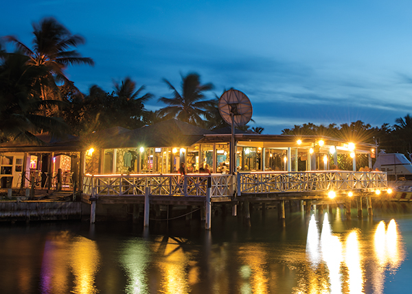 A photograph of The Sharkbite Bar & Grill sits over the water at Turtle Cove Marina, Turtle Cove, Providenciales (Provo), Turks and Caicos Islands.