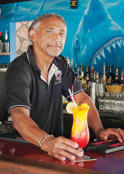 A photograph of Sharkbite Bartender Keith Hawkins is famous for his unique cocktails at Turtle Cove Marina, Turtle Cove, Providenciales (Provo), Turks and Caicos Islands.