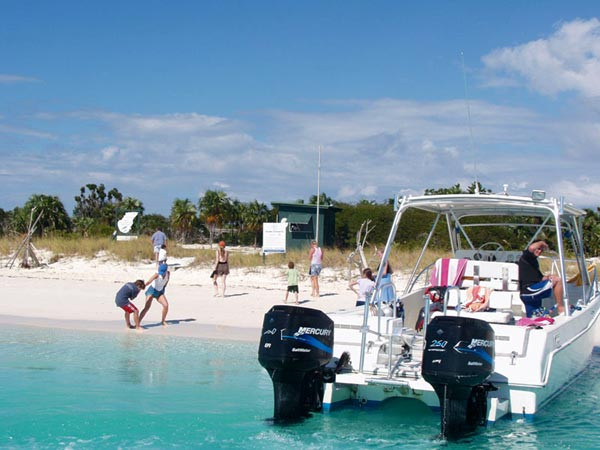 A photograph of a boat tour stop to see the iguanas at Little Water Cay, Turks and Caicos Islands, British West Indies