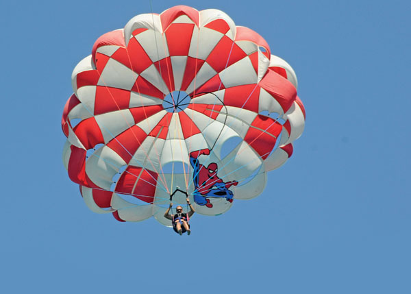 A photograph of Parasailing with Captain Marvin Watersports flying over Grace Bay Providenciales