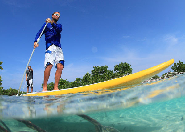 A photograph of Stand-up Paddle Boarding with Big Blue Collective, Providenciales (Provo), Turks and Caicos Islands