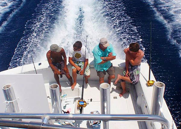 A photograph of a Panoply Sport Fishing and Charters boat heading out from Providenciales (Provo), Turks and Caicos Islands