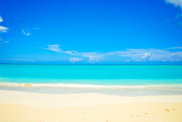 A photograph of Grace Bay Beach, Providenciales (Provo), Turks and Caicos Islands, British West Indies