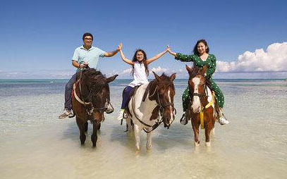 A photograph of horseback riding with Unique Tours on Blue Hills Beach, Providenciales (Provo), Turks and Caicos Islands.