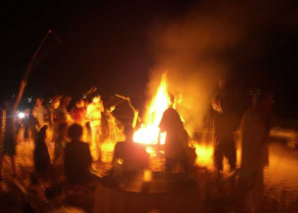 A photograph of the Full Moon Pig Roast and Bonfire on the beach on Providenciales (Provo), Turks and Caicos Islands