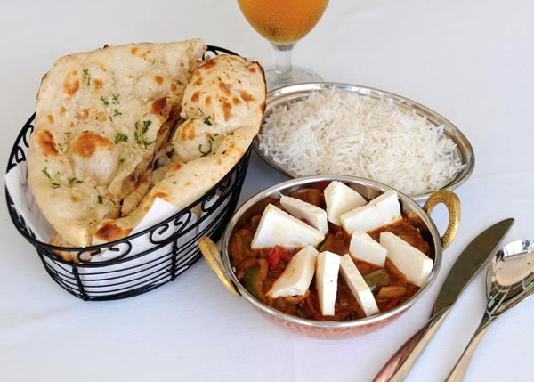 A photograph of Naan Bread served with Kadahi Paneer at Garam Masala Indian Restaurant, Grace Bay, Providenciales (Provo), Turks and Caicos Islands.