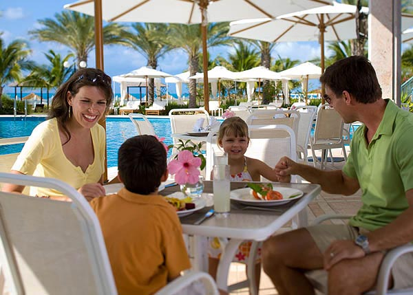 A photograph of guests dining at Sand Dollar at Seven Stars Resort, Providenciales (Provo), Turks and Caicos Islands.