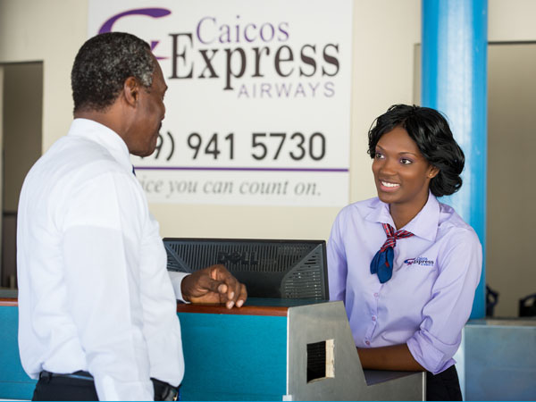 A photograph of the Caicos Express Airways welcome counter